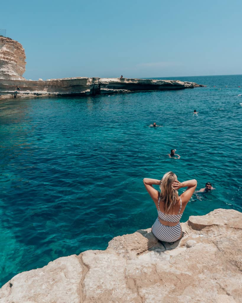 girl on edge of St. Peter's Pool, what to see in Malta