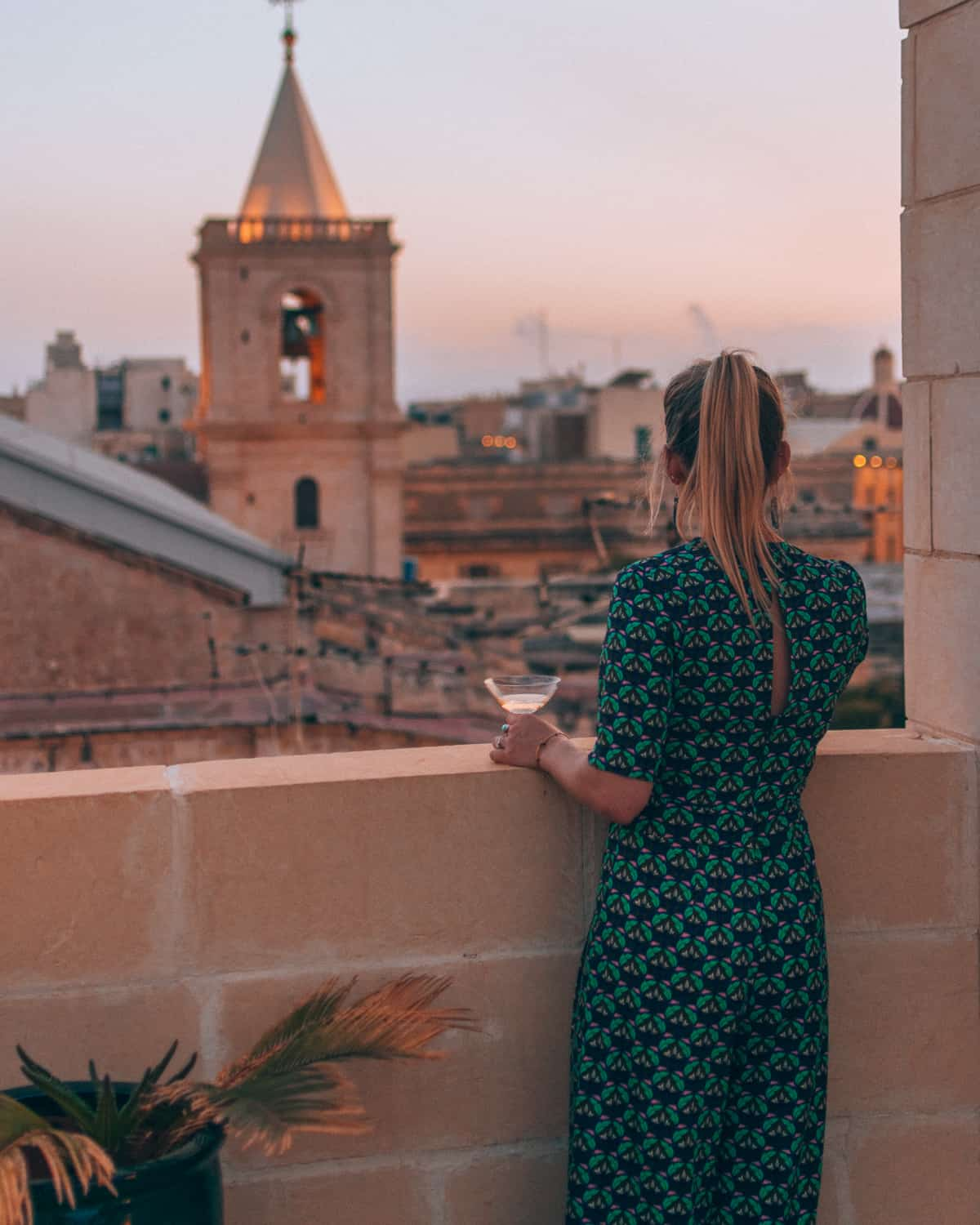 girl looking out over Valletta at U collection apartment