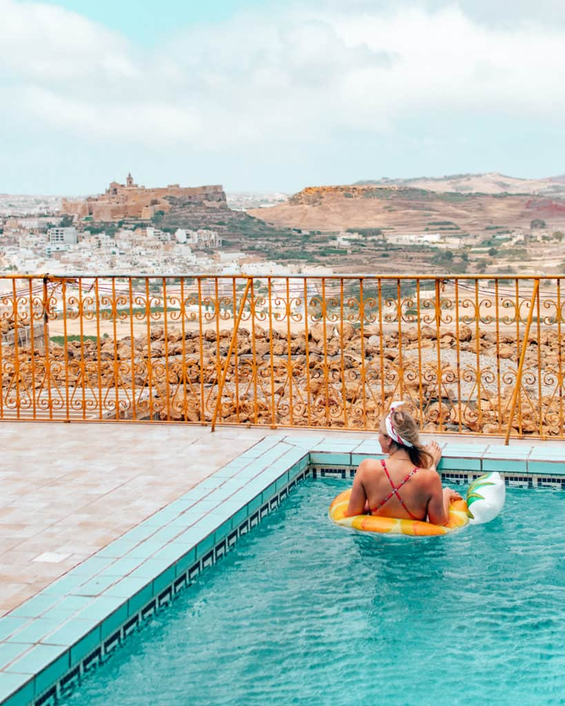 girl in pool with view