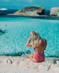 Girl overlooking the blue lagoon