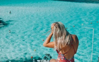 Girl overlooking the blue lagoon