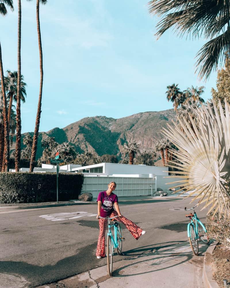 girl putting leg over bike