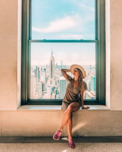 Sitting in window at top of the rock NYC, one of the best Instagram spots in NYC