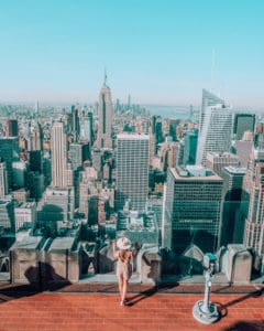standing at the top of Rockefeller centre one of the best Instagram spots in NYC