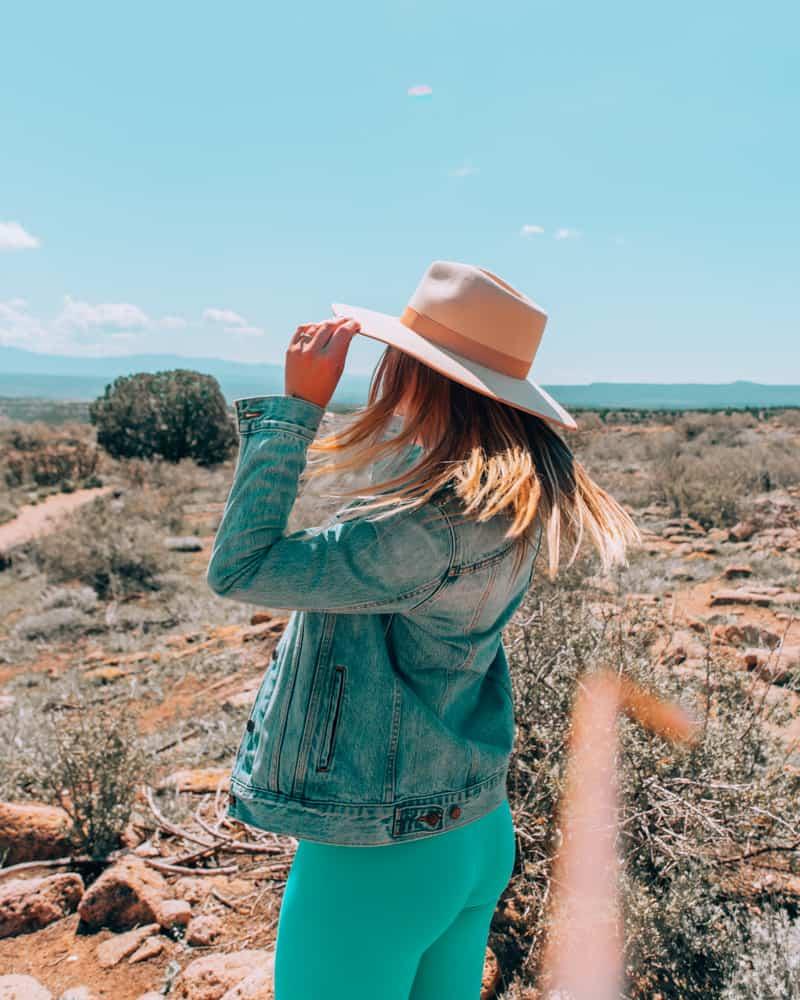 girl wearing cowboy hat at Bandelier