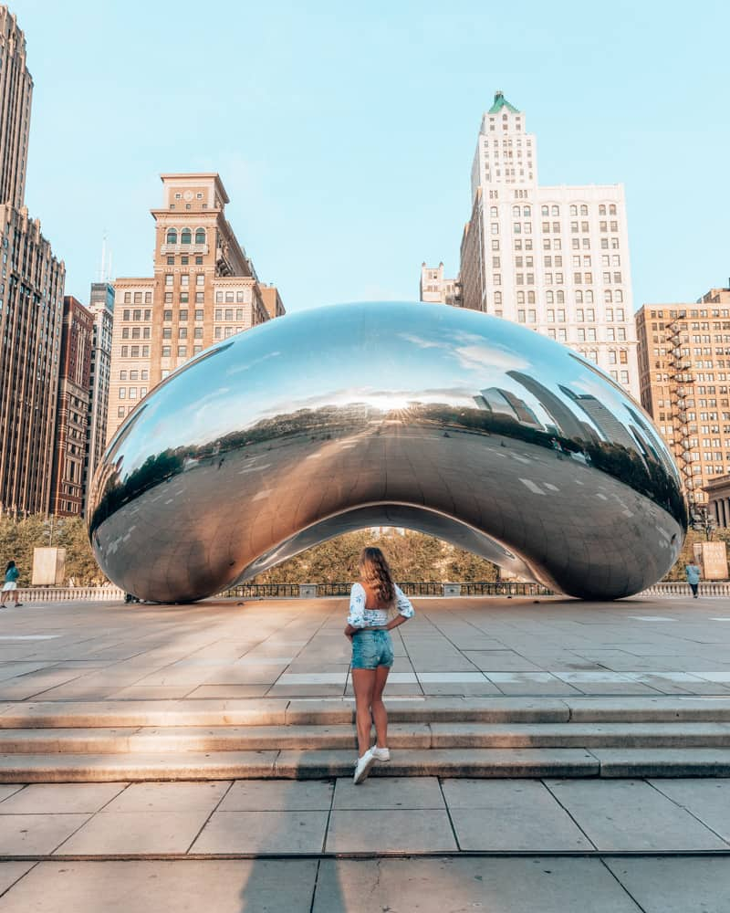 girl standing in front of the bean