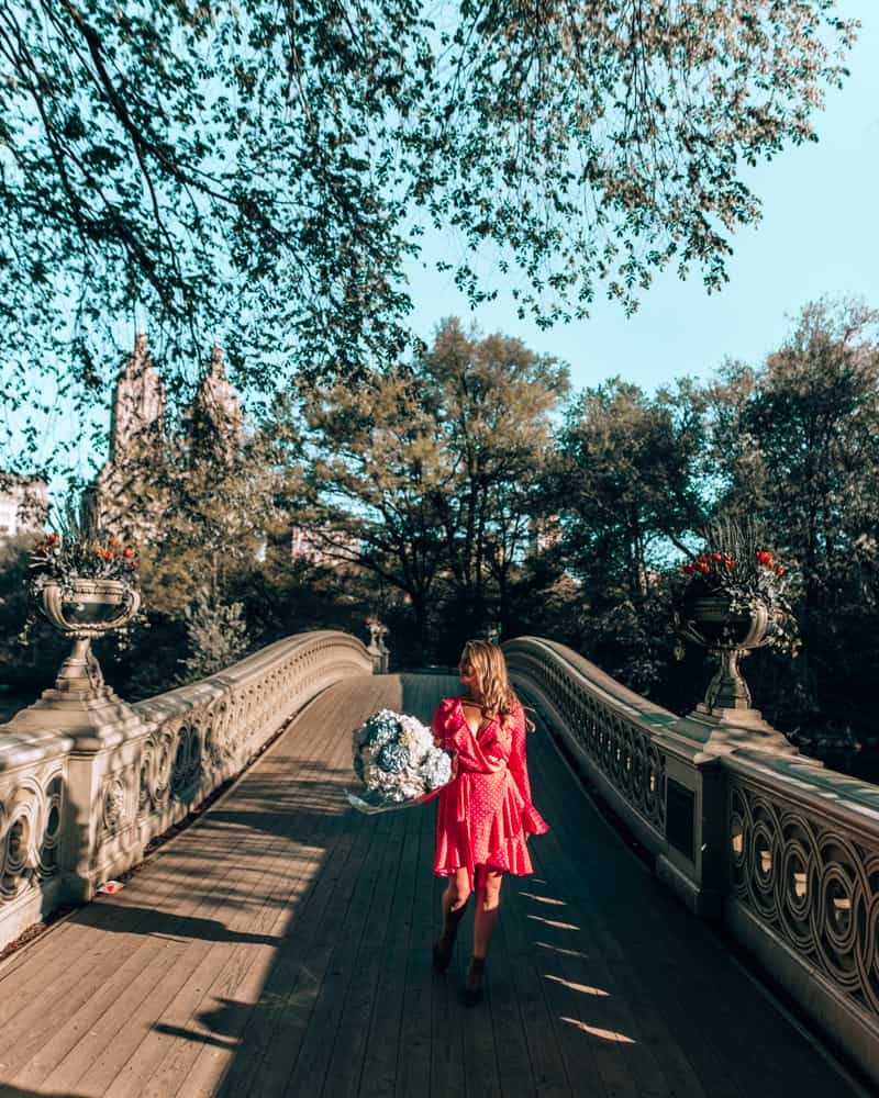 walking on Bow Bridge in Central Park on of the best Instagram spots in NYC