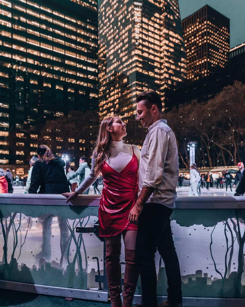 couple standing in front of ice skating rink