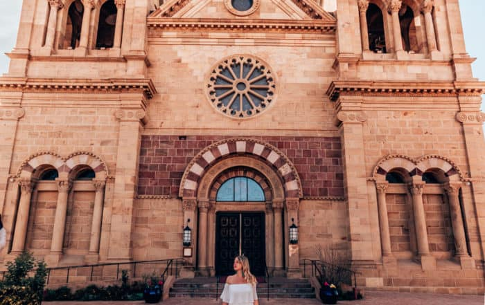 girl standing in front of Cathedral