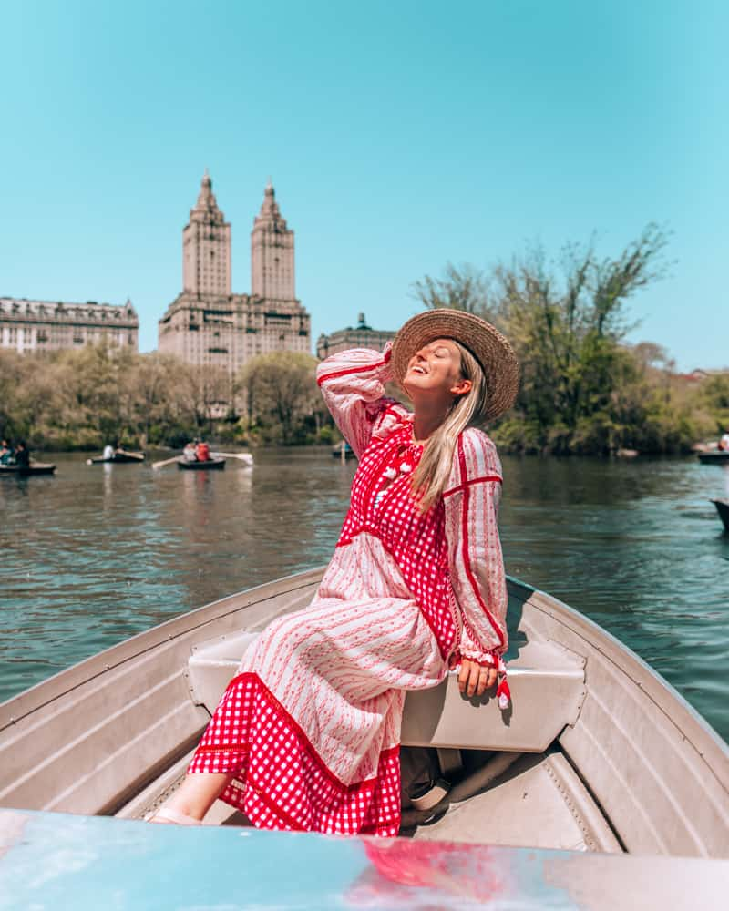 on a row boat in Central Park on the best Instagram spots in NYC