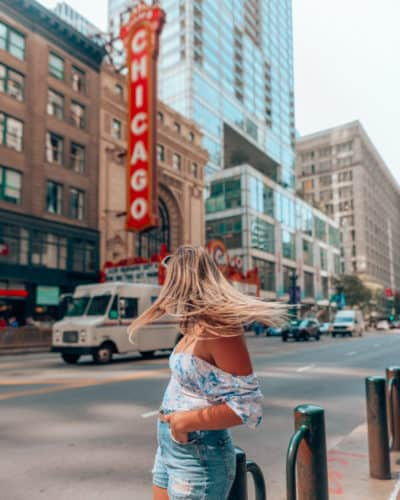 girl standing outside Chicago theatre