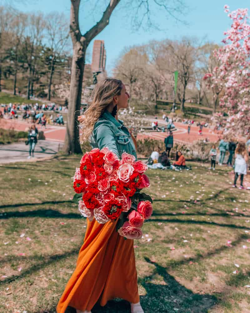 holding bouquet in Central Park one of the best Instagram spots in NYC