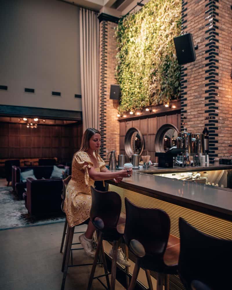 girl sitting at hotel bar