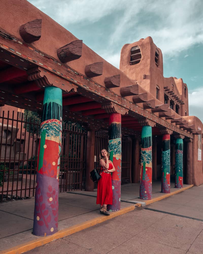 standing in front of the IAIA museum of contemporary art in Santa Fe