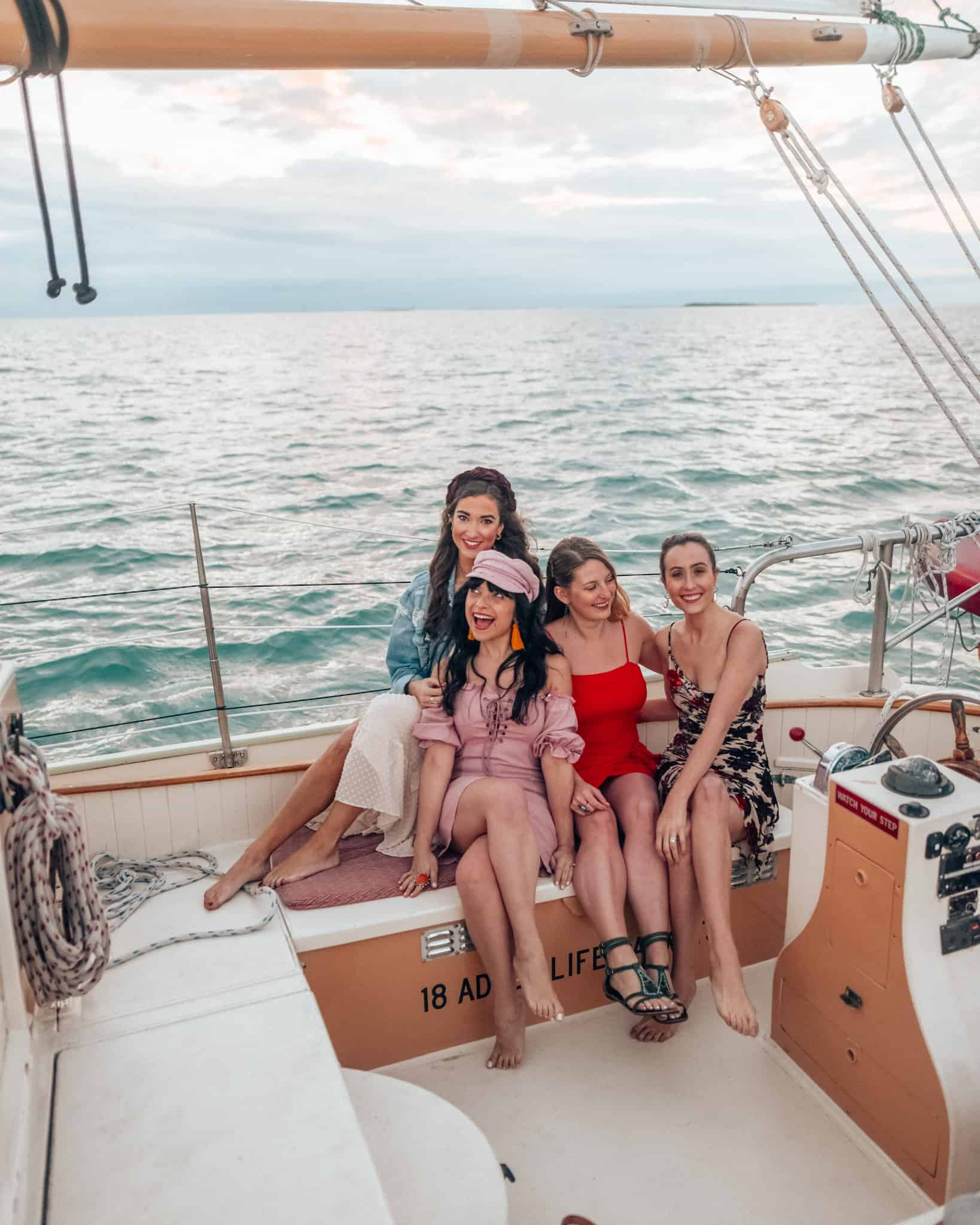 girls on a sail boat at sunset