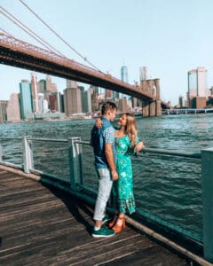 couple standing at dumbo waterfront
