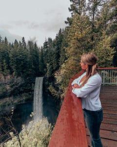 girl looking at waterfall