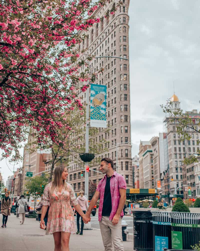 couple standing in front of the flatiron building