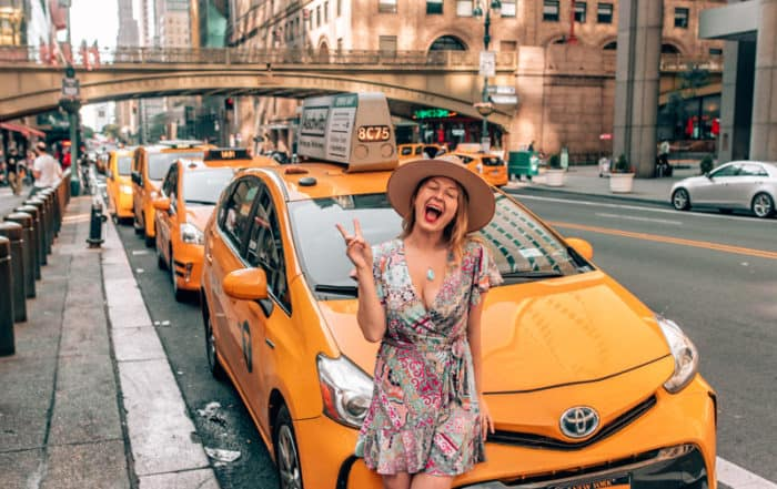 girl sitting on yellow cab