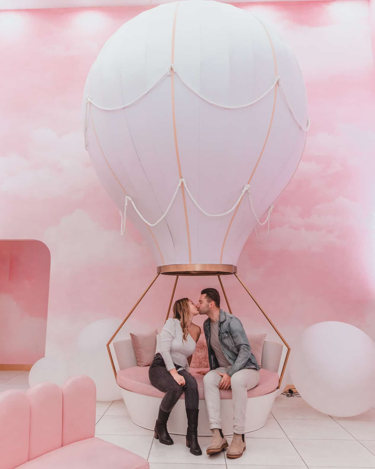couple sitting in pink cafe