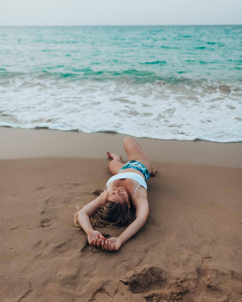 girl laying on beach