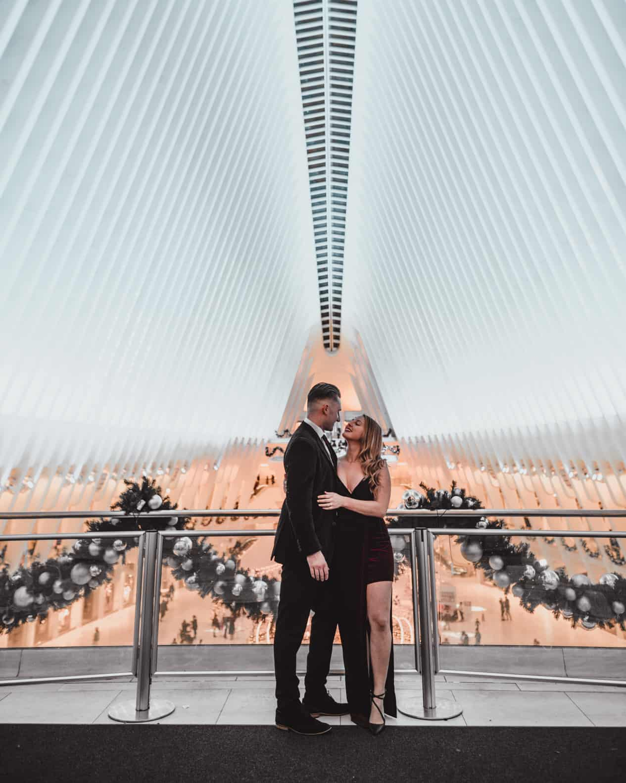 couple standing at the oculus
