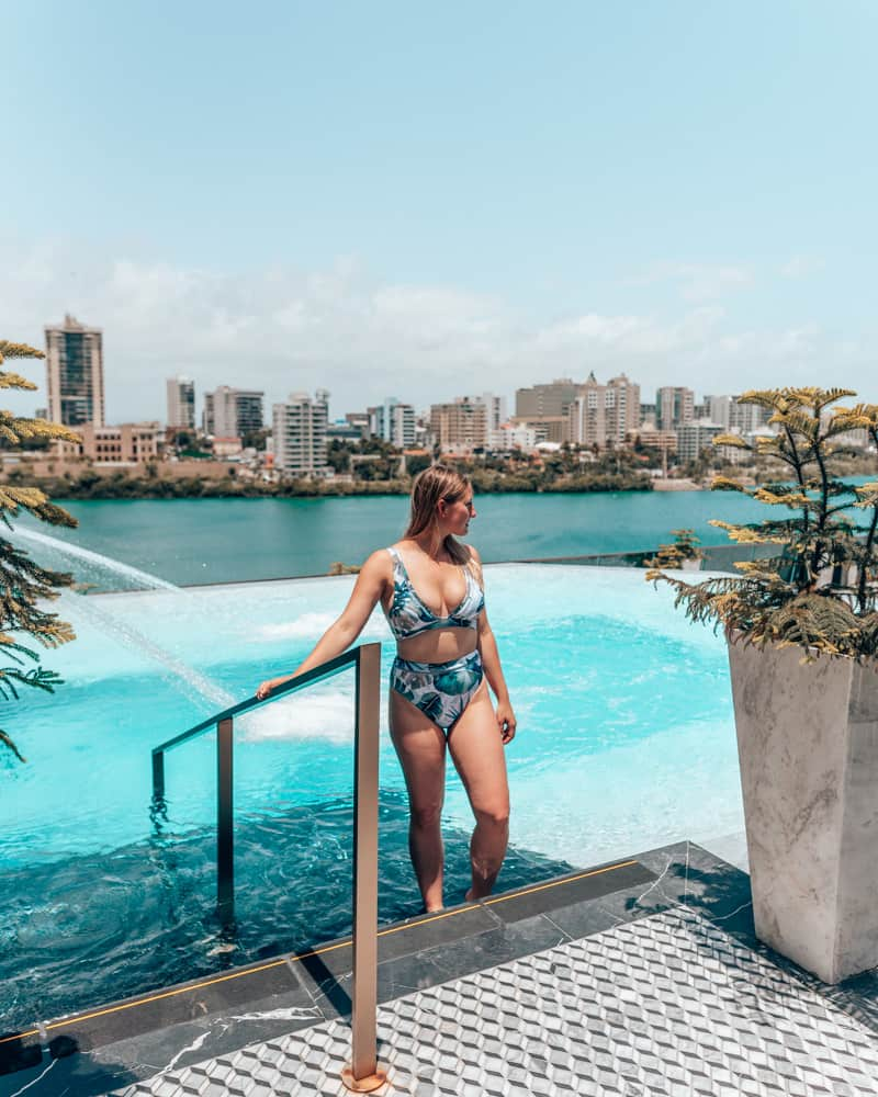 girl getting out of rooftop pool