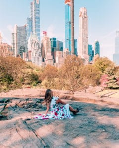sitting on a rock in Central Park one of the best Instagram spots in NYC