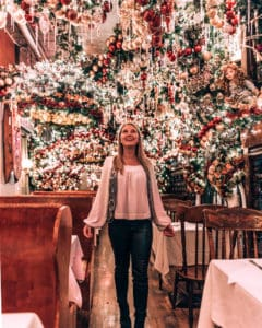 girl standing in restaurant with Christmas decor