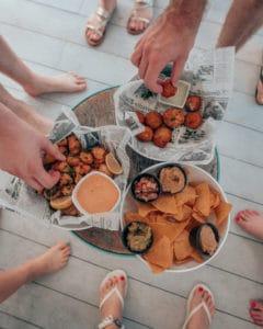 hands grabbing food