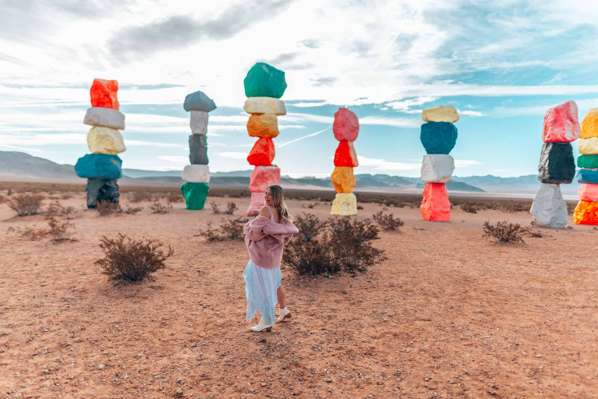 girl standing in front of Seven magic Mountains