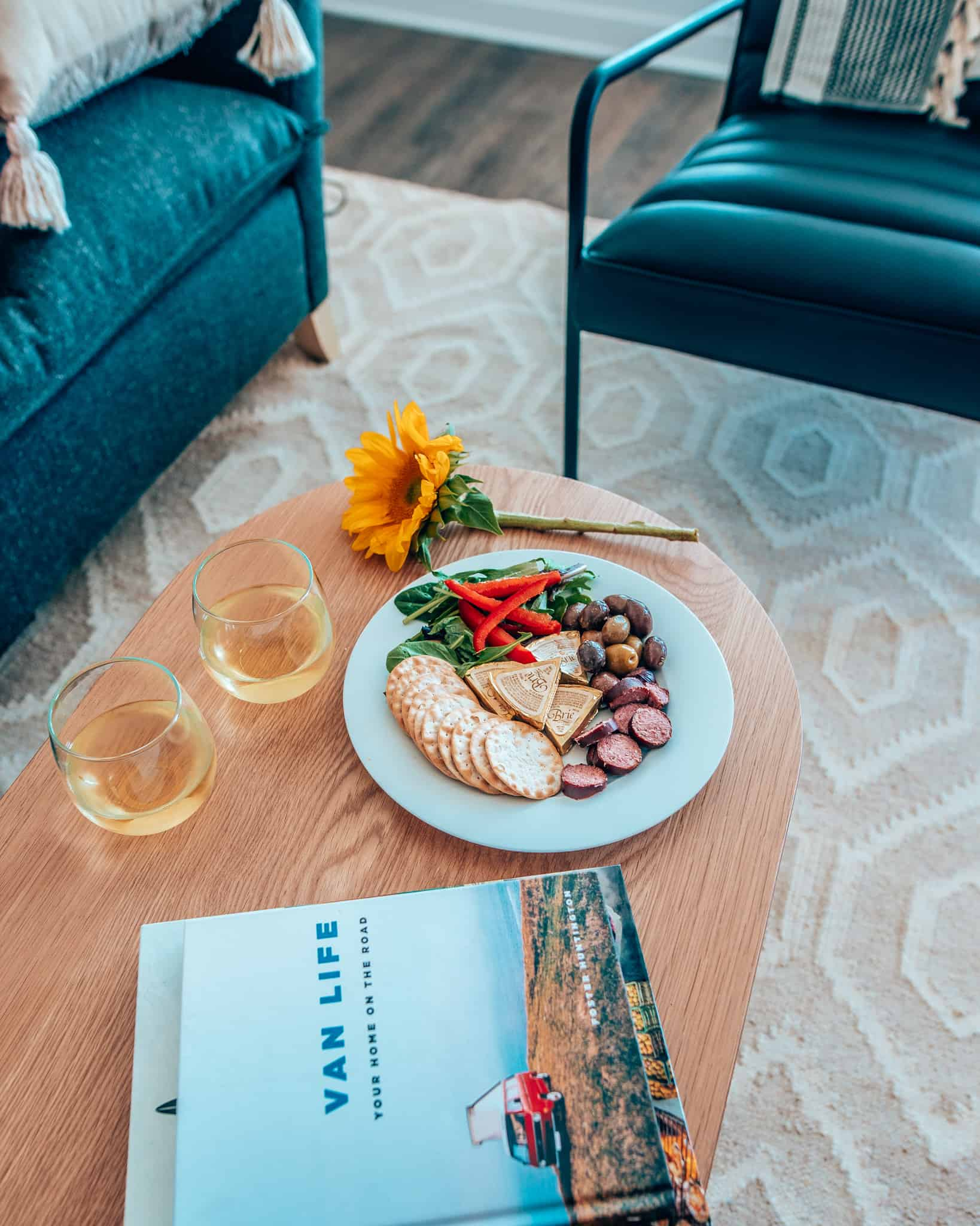 wine and snacks on wooden coffee table at Sonder Apartment