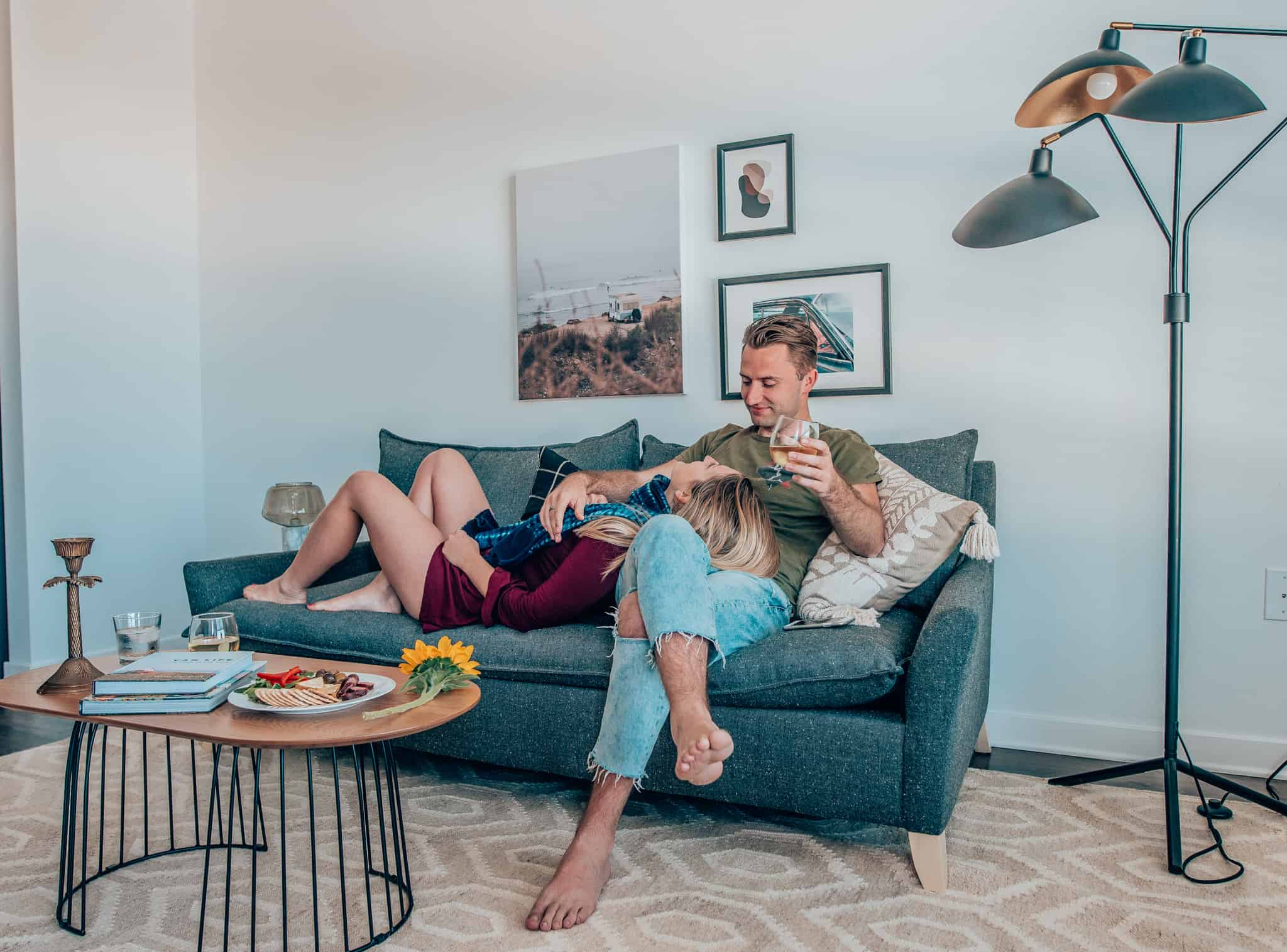 couple laying on couch at Sonder Apartment