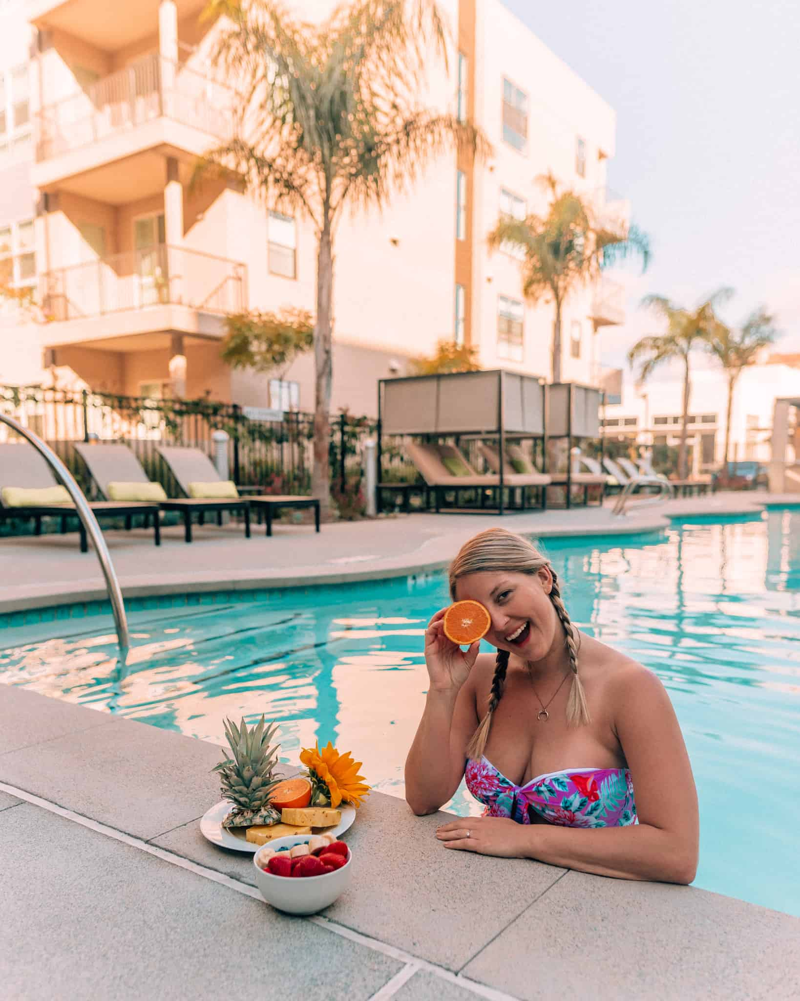 girl with fruit at side of pool at wonder apartment