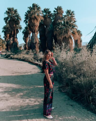 girl standing in front of palm