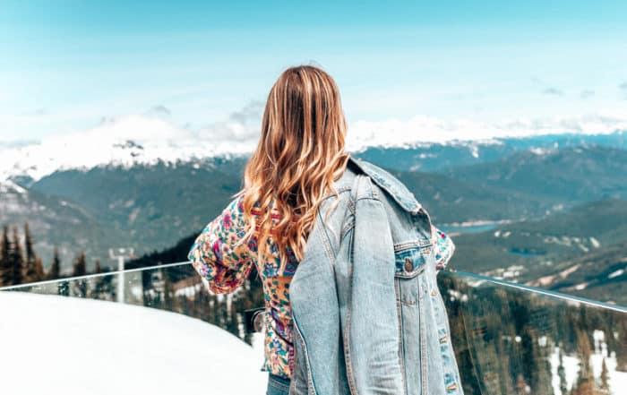 girl standing at whistler peak