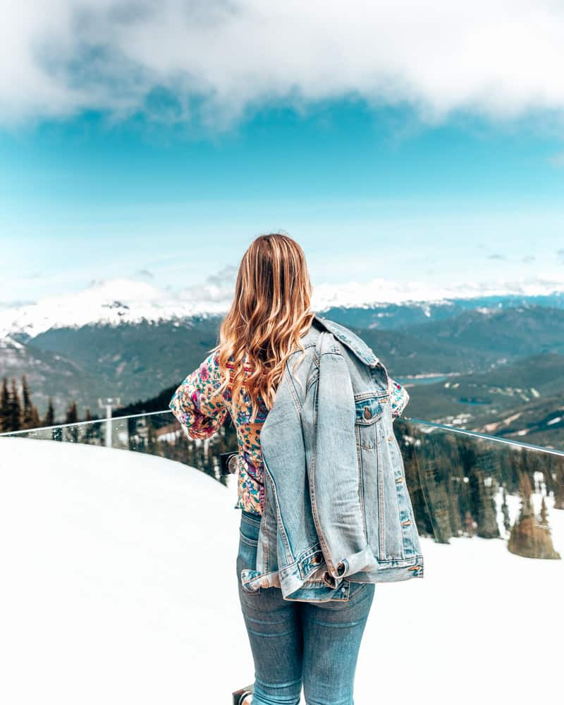 girl standing at whistler peak