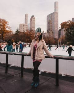 girl standing in front of skating rink