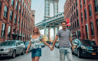 couple in front of Manhattan bridge